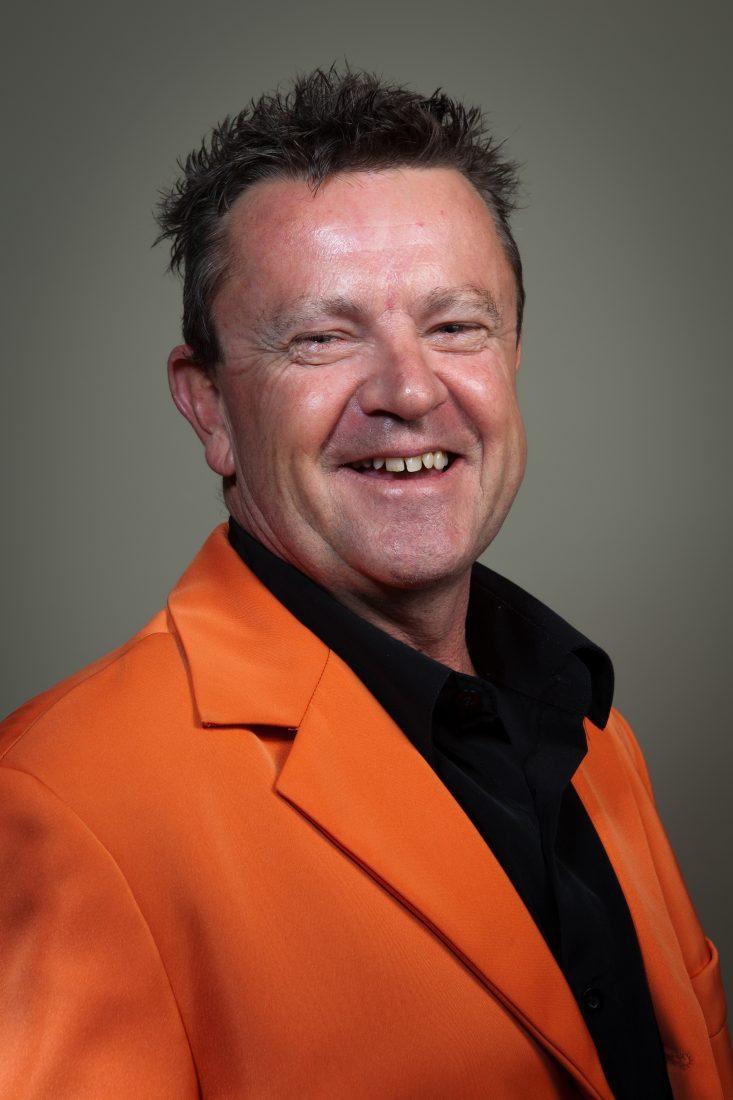 Image of Jaffaman Eddie Copywriter, Australian Entrepreneur & Marketer in orange suit