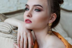 Woman wearing gold earrings image