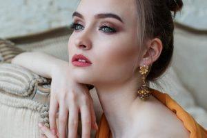 Woman wearing gold earrings image