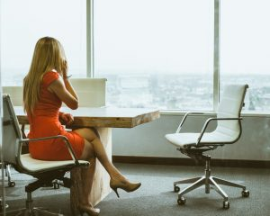 Image of business woman in orange dress at work