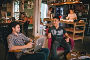 Image of two guys chatting over laptop Small Business Marketing & Mindset Tips