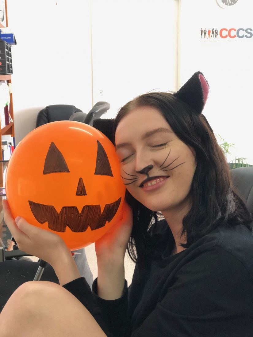 Image of Jessie with halloween balloon Creative Copywriting