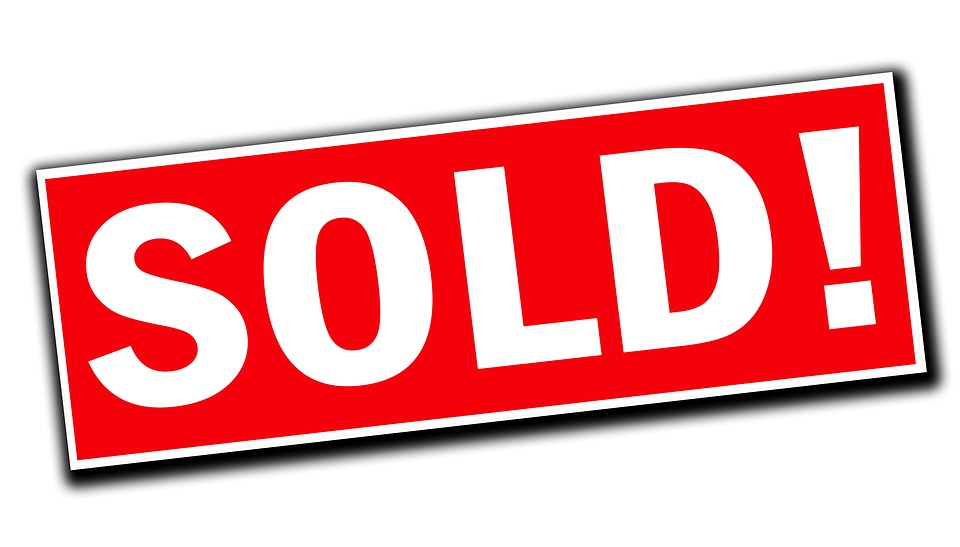 rred & white sold sign real estate copywriting image