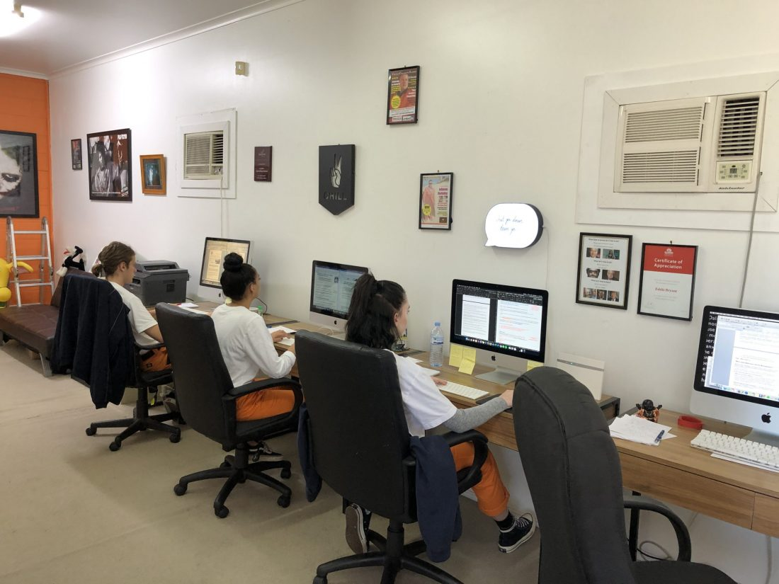 Creative copywriting and content solutions staff working on macs at desks in office 2019